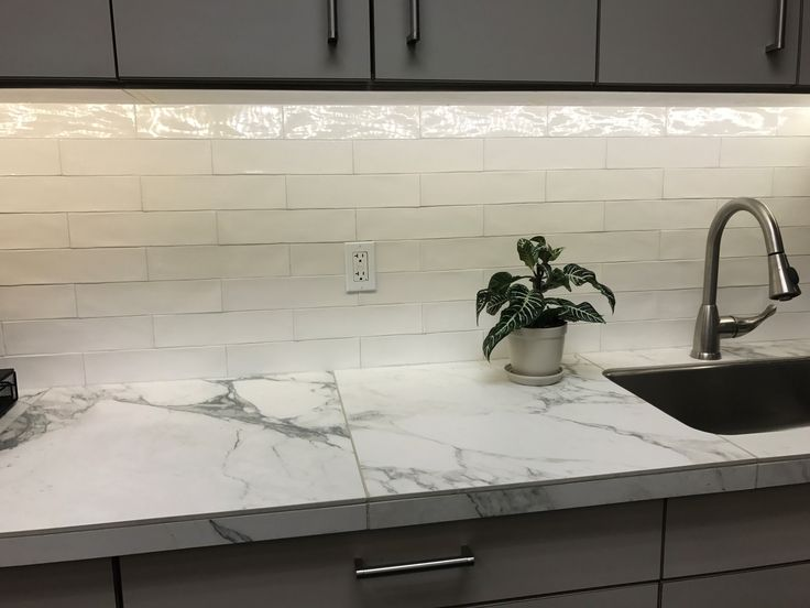 We'd be remiss if we didn't feature one of our favorite tiles in our showroom! Victoria, shown in White, adds a modern, yet classy elegance.  #tile #midcentury #mosaic #ceramic #spanishtile #victoria #white #cream #subwaytile #wall #backsplash #accent #install #room #remodel #design #inspiration #surfaceartinc #tilevisualizer