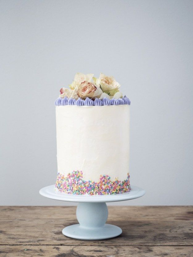 A tall and beautiful birthday cake