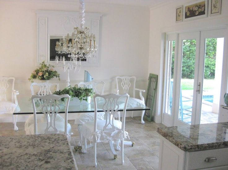 Beautiful Dining Room With Glass Topped Table And Stunning Chandelier Franksglass