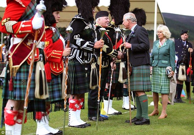 Nice to meet you: The Prince of Wales and the Duchess of Cornwall greet Drum Major Bert Summers 14 aug 2014