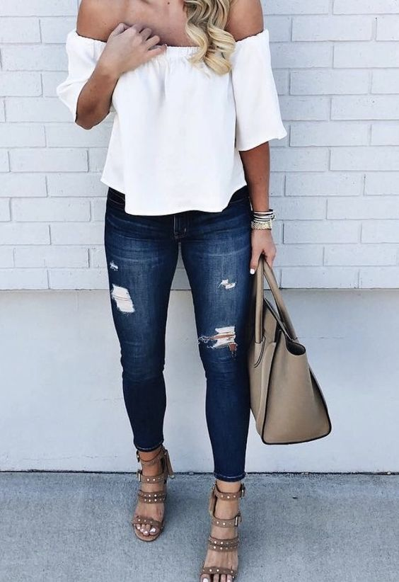 Off the shoulder white top with jeans / Instagram @designsonavineboutique