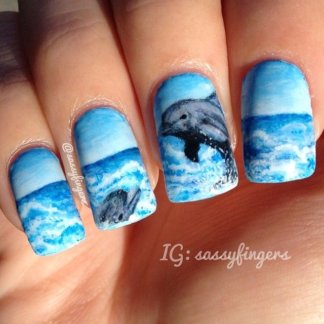 I believe dolphin is one of the most beautiful creations of God. I got my inspiration by one of the Pisut Masanong's creation. He is incomparable! Just amazing! I'm happy on how this turned out.:) I hope you like. I'll try to do some holidays nailart soon.