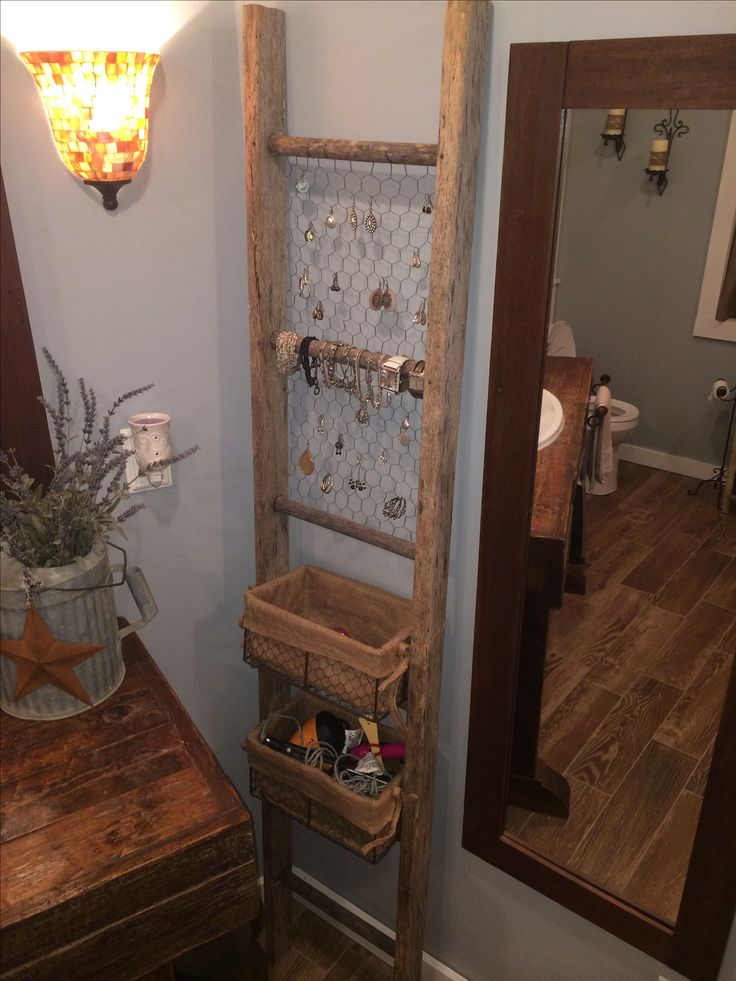 Old ladder used for bathroom organization. Could redo the vanity in the 1/2 bath…
