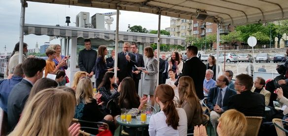 On Friday, May 15th, 2015, after a long day of orientation for our 32 Hungarian Fulbright grantees for AY 2015, US Ambassador Colleen Bradley Bell addressed a boatload of Fulbrighters, family and friends. Ambassador Bell helped us say goodbye to our 9 student and 4 scholar grantees from the States who will depart Hungary soon, and in the words of many, will be back many a time. Our 32 Fulbright grantees leave for the US in August, some in January. They represent 18 students and 14 scholars…