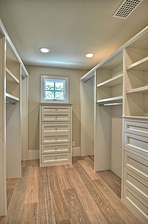 Organization is not a problem in this spacious closet with plenty of drawers and shelves.  Finish carpentry adds beauty and function.