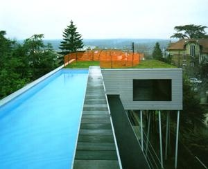 Rem Koolhaas, Villa Dall'Ava, near Paris ; Koolhaas' first construction, cute little house with a view from the pool onto Paris.