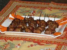 Learn how to cook chicken livers. This Rumaki recipe is great appetizer! Marinate chicken liver in soy sauce marinade for 2 to 3 hours. Wrap chicken liver and water chestnut in a piece of bacon; secure with a toothpick. Broil for 3 minutes on each side until cooked.