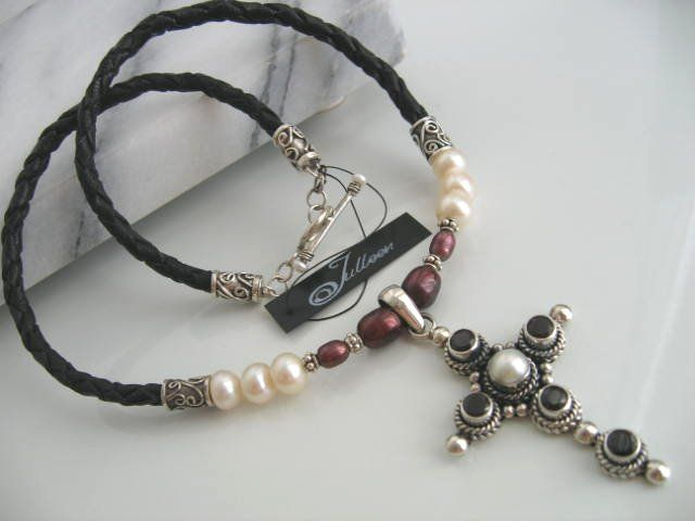The red garnet and pearl cross set on leather and pearls in sterling silver