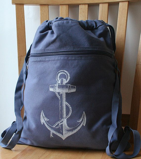 Anchors away! A blue, 100% cotton canvas backpack/cinch sack that has been screen-printed with the image of an anchor.