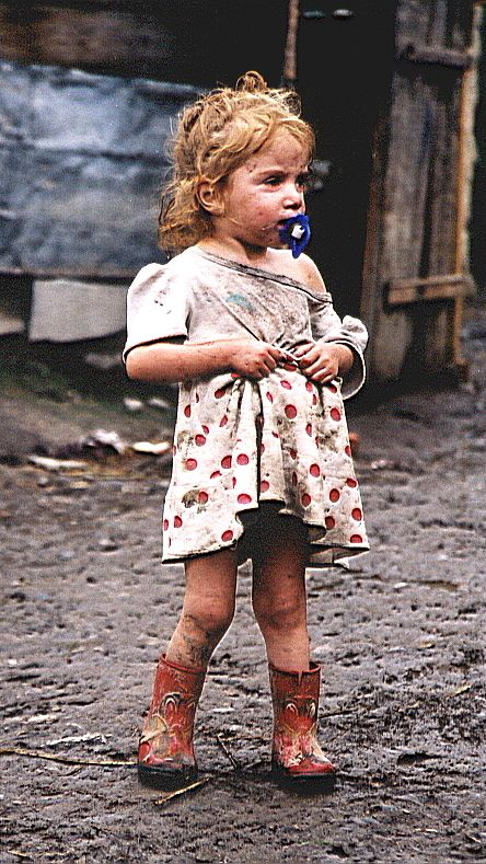 -Economy-  The photograph above shows a young girl who lives in Mukachevo, Ukraine. 40,000 of the people who live in this region live in extreme poverty.  The population below poverty line in Ukraine is 24.1%. The population below poverty line is the estimated percentage of population that is that is falling below the poverty line.