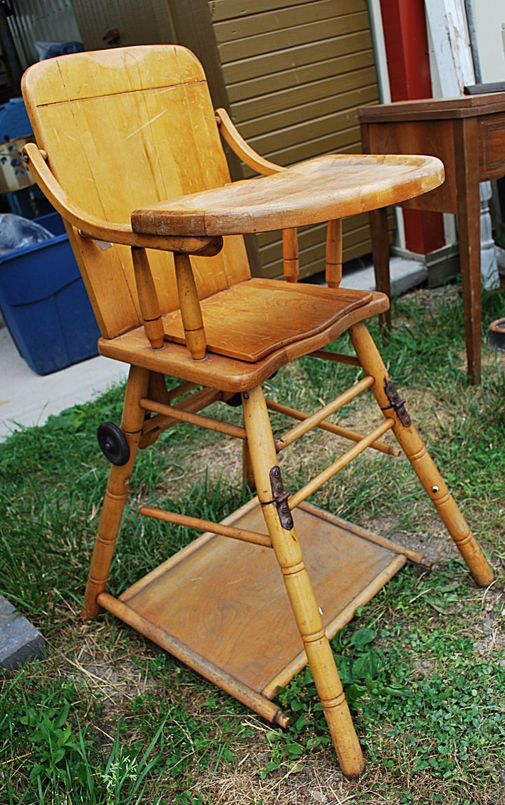 Old wooden high chair, complete with tray and hinged legs