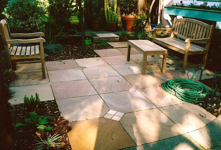 Photo of Tamar Carson Landscaping - Oakland, CA, United States. Indian slate patio with tile insets