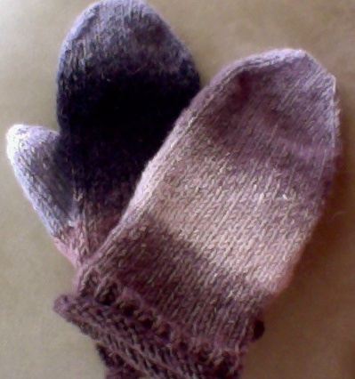 "On a trip to Ottawa I rediscovered extreme cold, and found myself knitting a pair of mittens.  These are my ""Ottawa Solstice Mittens"" made from Casacade Yarn's Casablanca: wool, mohair, and silk.  Toasty!!"