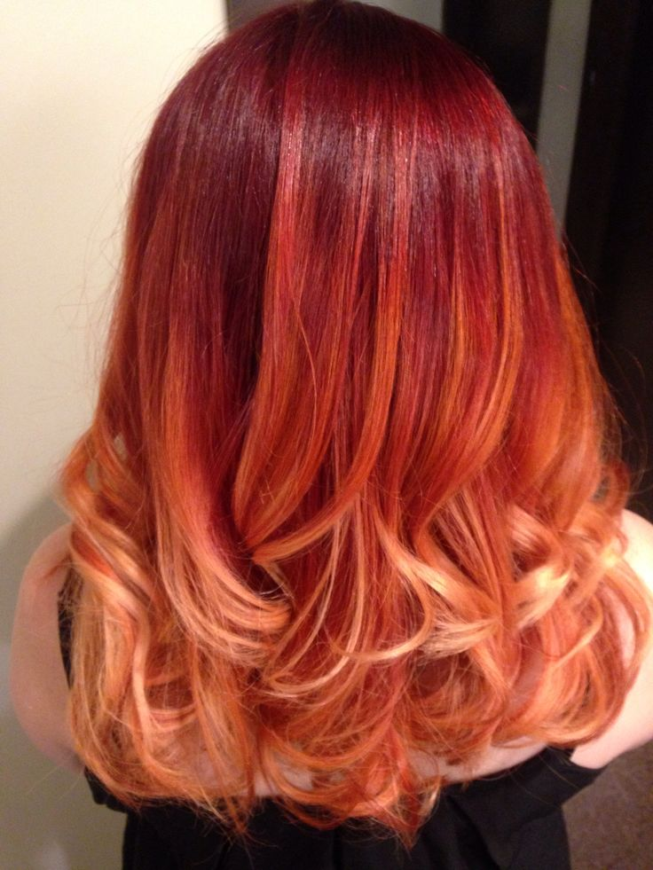 Red ombré, medium length hair. Done with aveda color