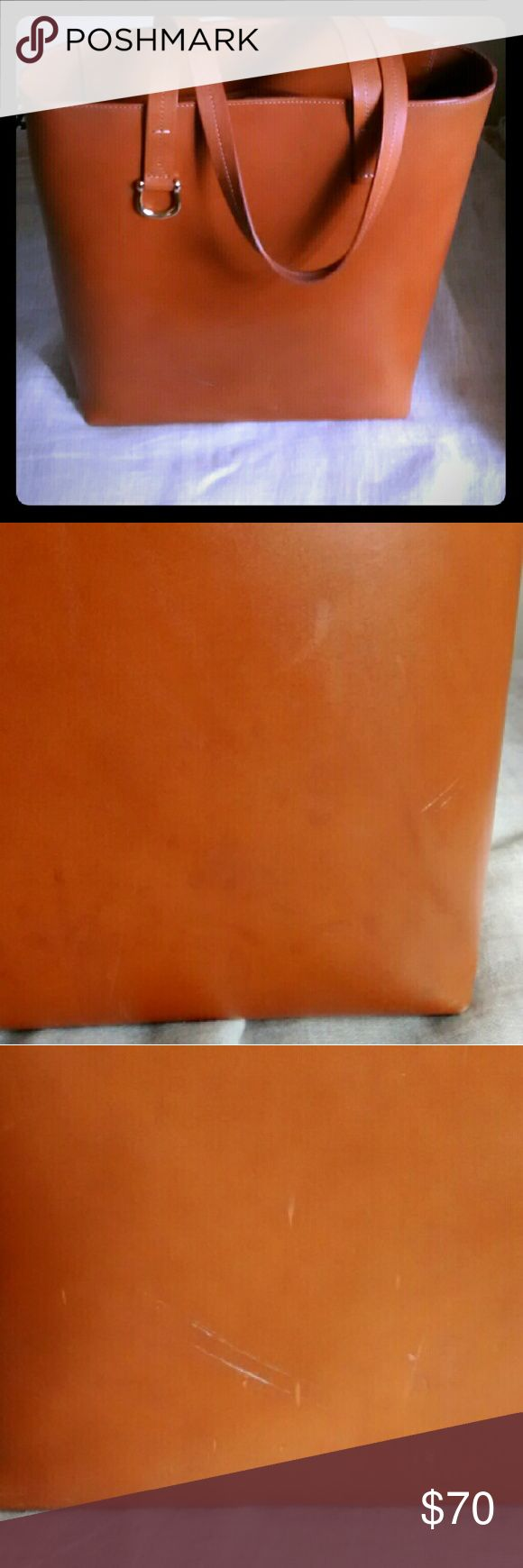 & other stories leather tote Large vegetable tanned leather tote. One interior pocket. Very structured. Several scratches, see pics. These can probably be fixed, but price reflects the imperfections. Buckle detail on one side. & other stories Bags Totes