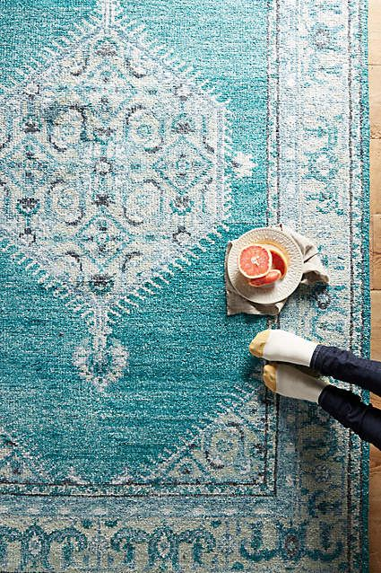 Loving this blue rug that would add a great pop of color to any room, yet is somehow still a wonderful muted tone that won't look crazy in the average room
