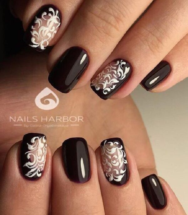 Dark glittery + tigerry Nail Art. Another nail art design on the list that carries fiery tiger is next that is bit different but much classier. The details of the tiger and glitter work when done well, can give this amazing output.