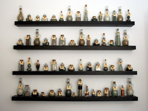 25 best ideas about bottle display on pinterest man for Glass bottle display ideas