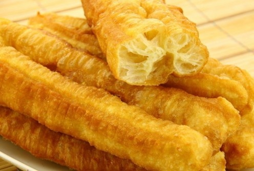 Deep-Fried Dough Sticks     normally eaten as an accompaniment for rice congee or soy milk.    available throughout Asia