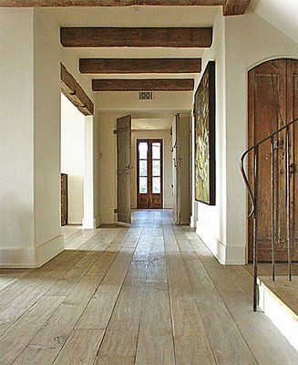amazing floors - bleached oak. Love the ceiling beams and the light. Nice having a door or window at the end.