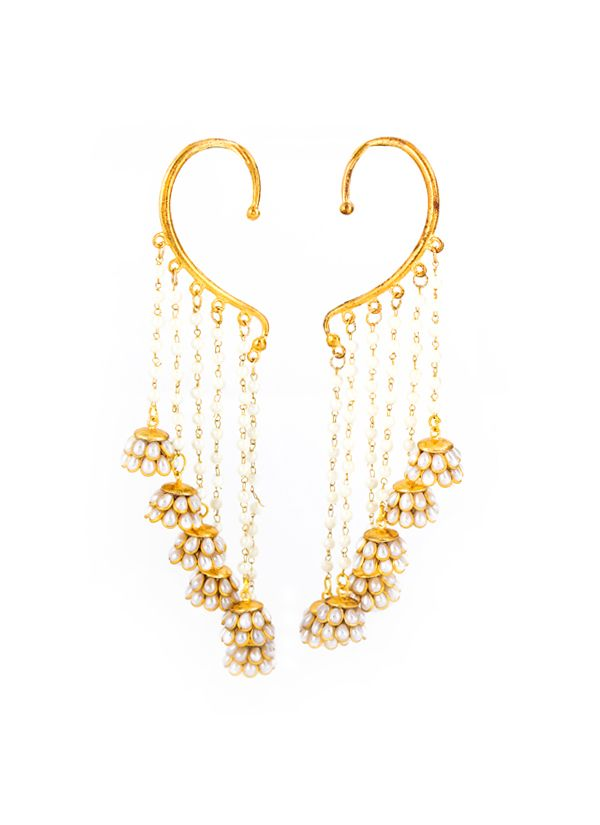 Pearls set in gold are a classic combination that never goes wrong when paired with traditional attire. Ragini Mittal brings them together in an unconventional piece of jewellery that can replace your regular jhumkas to create a fashion statement. The earcuffs seamlessly blend traditional and modern elements with six Paachi work flowers dangling from pearl chains all along the length of the cuffs. Wear it with your favourite anarkali or lehenga for a look that leaves a lasting impression.
