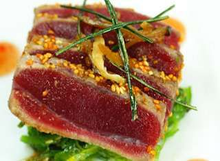 Here is an interesting recipe Sesame Orange Crusted Big Eye Tuna With Chuka Salad and a Sweet Chili Reduction that I have found from Sysco    www.chefref.sysco.com/Recipes