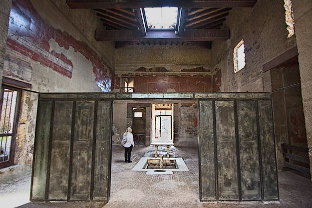 Herculaneum: Sliding wooden panels that separated the main salon from the interior garden in House of the Wooden Partition were instantly turned to charcoal by the pyroclastic material and preserved in situ, an exceptional survival