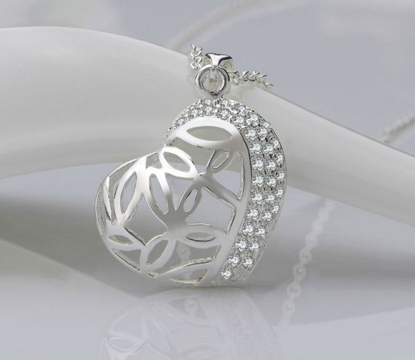 """Gorgeous Sterling Silver Heart Pendant Necklace with crystals. This a """"I Love You"""" patterned fine necklace to wear with the evening gown out on the town. Popcor"""