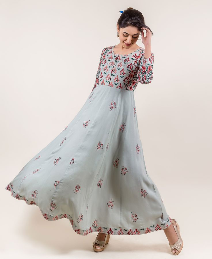 This ravishing anarkali long dress in mint will stun all-round the family gathering and make you look like a glamorous diva.