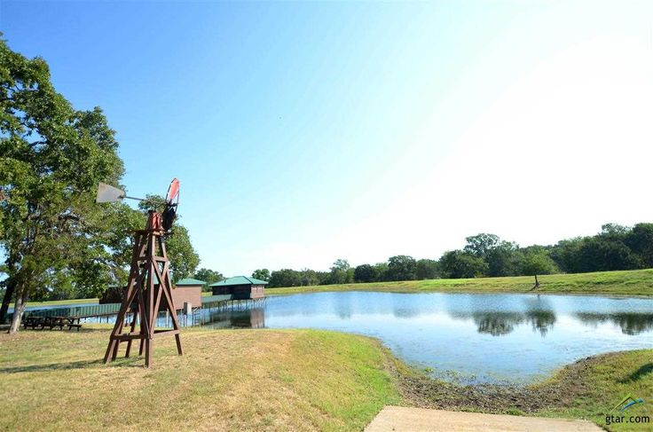 146+ Acre GAME RANCH*Rolling Terrain*8 Acre Stocked Lake with Boat slip*Ponds*LOG home 2400sqft & 6 car garage*Game Room or Guest Quarters with full K