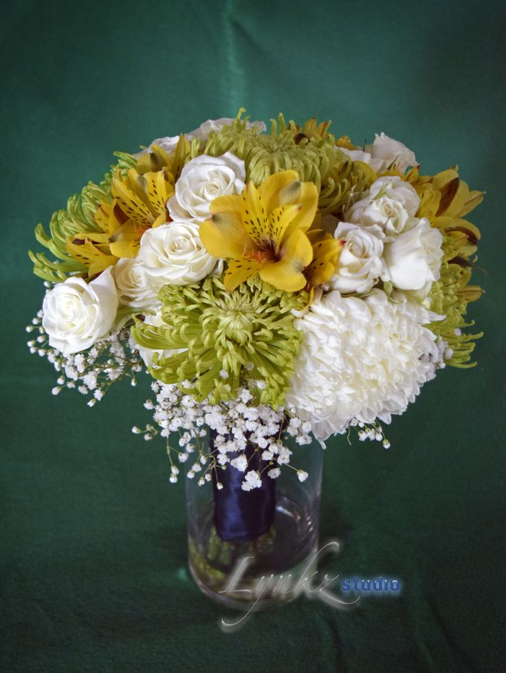 Bridesmaids bouquet from gren spider chrysanthemums, yellow alstroemeria, white spray roses , white football chrysanthemums and baby's breath as filler