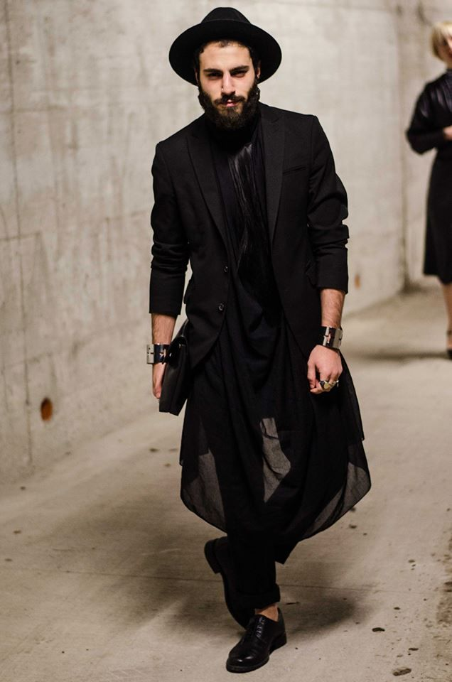 The art of fashion. Wait, he isn't really Chasidic, is he? I thought they were religiously opposed to a sense of fashion!