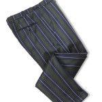 """pantalone regimental in tessuto inglese triplo ritorto, realizzato su fit """"clochard"""" dal montante più comodo ed il fondo alla caviglia risvoltato"""