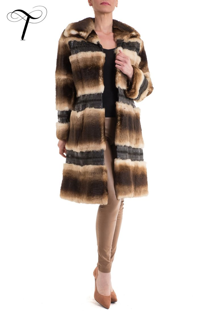 STRIPED RABBIT COAT WITH LEATHER INSERTS  This #stylish, yet #sophisticated #furcoat is the epitome of contemporary #elegance. Designed by #toutountzisfurs in a slightly fitted line, it is crafted from soft rabbit #fur among which elaborately embroidered #leather inserts have been inlaid.  The #coat features a spread collar, two front slot velvet pockets and #satin lining. Easy to pair with denims and boots or a dress and high heels, it will be an indispensable piece for your…