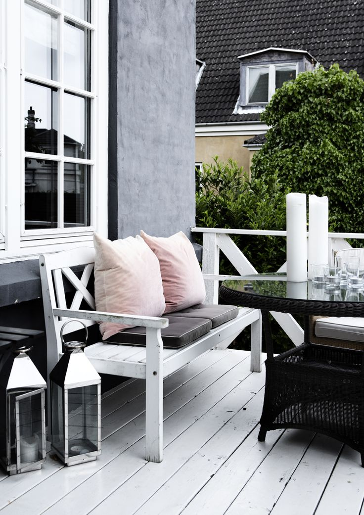 Patio of Marie Sand, photo: Line Klein  Bench top deck, table in front, look out in yard while eating