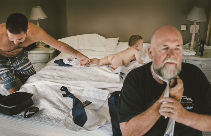 Dad doing the ties, the little fella trying to escape - 3 generations getting ready for the big day ahead.