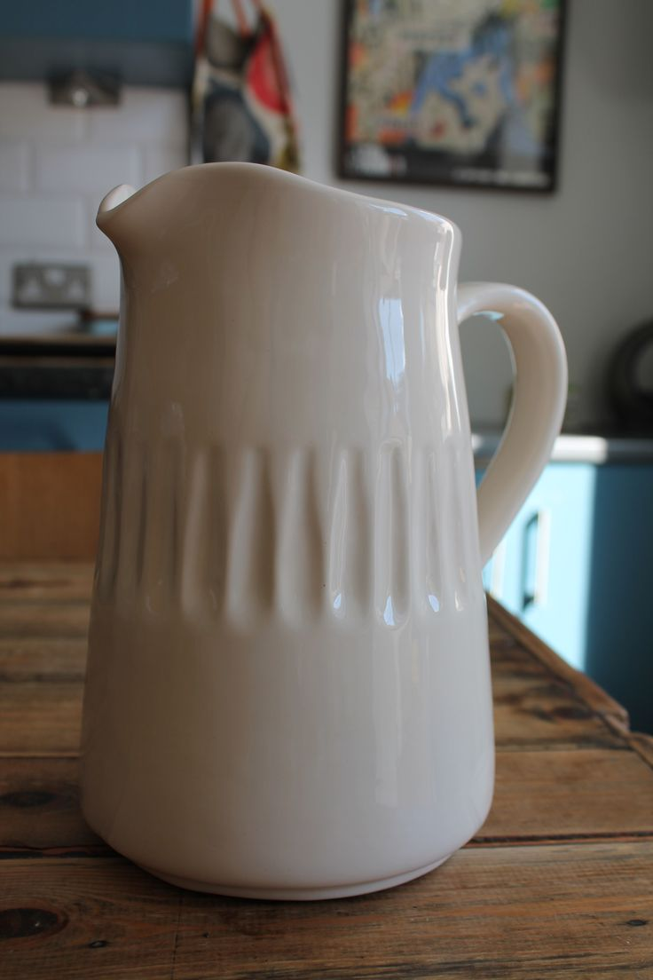 A simple, elegant and beautifully designed off-white ceramic jug by Rice.