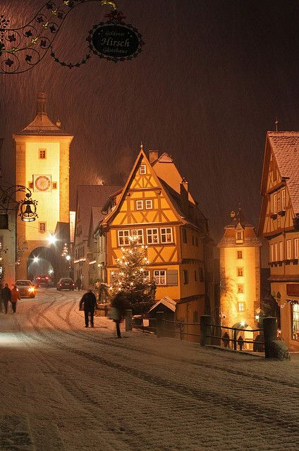 Snowing at night in Rothenburg ob Der Tauber, Bavaria, Germany