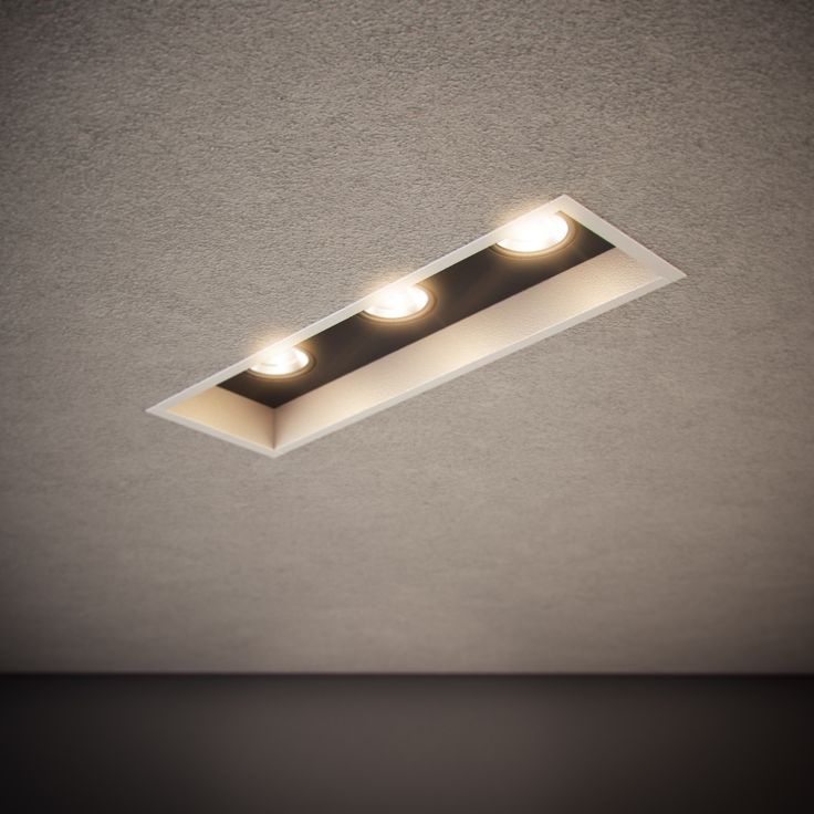 Triple Down is a recessed luminaire with 30mm of recessed trim. The internal blind cover can be coloured to match its trim or in contrast as an architectural feature. Available in single, double, triple and quad configurations | http://www.darkon.com.au/product/triple-down/