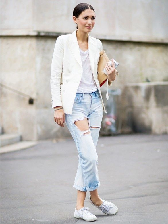 ripped jeans paired with a crisp blazer