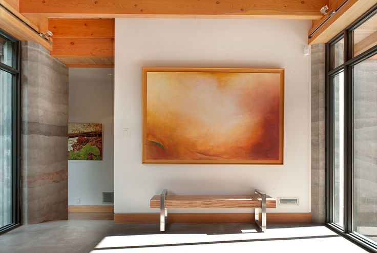 Bright front entry - Rammed Earth Walls highlighted throughout.