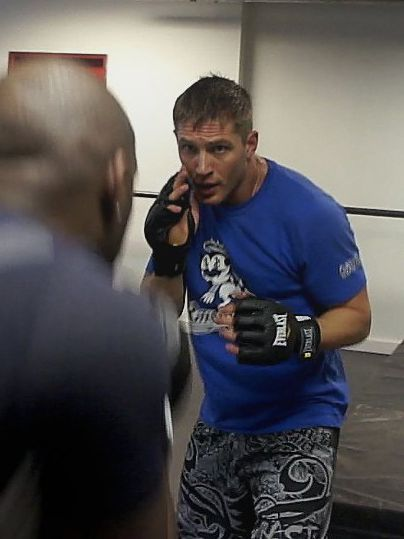 Tom looks GOOD here training for Warrior. He looks Very Serious & Very Sexy