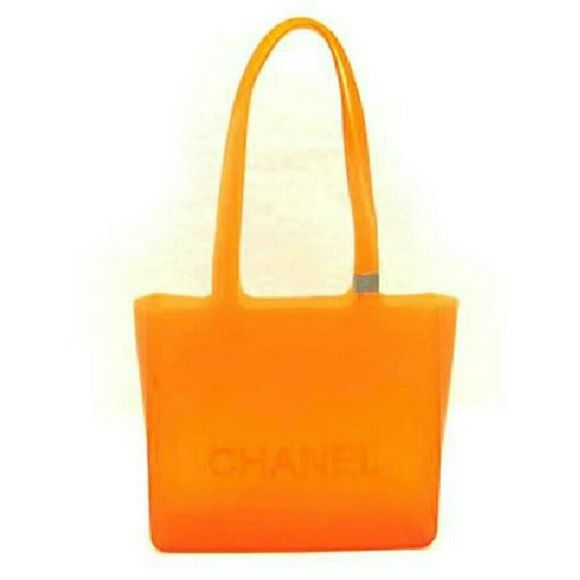 """Chanel   218781 Orange Tote Bag  "" This item will ship immediately!!  Previously owned.  Made In: Italy  Signs of Wear: Exterior shows minor wear with some water spots,   light scratches and scuff marks. Corners show some wear little to no wear.  Color appearance may vary depending on your monitor settings.  Measurements:9.64""L x 8.5""H x 2.95""W  Gently Used  SKU : 218781 CHANEL Bags Totes"