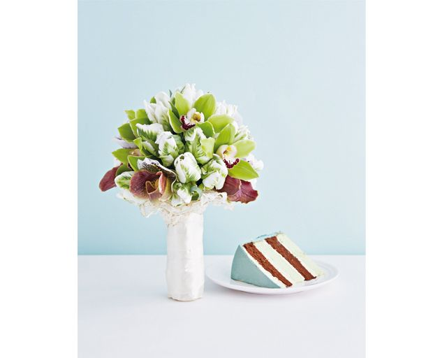 A clutch of luscious blooms in unexpected shades is refreshingly modern against a white dress for your big day.  Parrot tulips, cymbidiums and paphiopedilum orchids (or lady's slippers), $480, from FIORE DORATO. Plate, stylist's own. http://www.herworldplus.com/weddings/go-local-gorgeous-orchid-blooms-your-wedding-bouquet