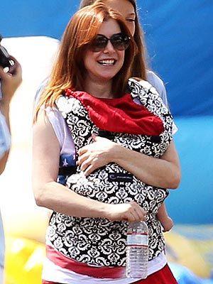 Alyson Hannigan carries baby Keeva in Ergobaby's Petunia Pickle Bottom Frolicking in Fez