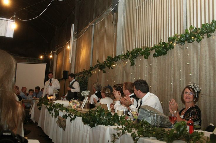 Top table bridal party. Best men giving a speech