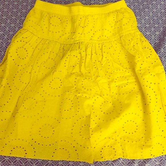 Yellow eyelet skirt Excellent condition yellow skirt Skirts