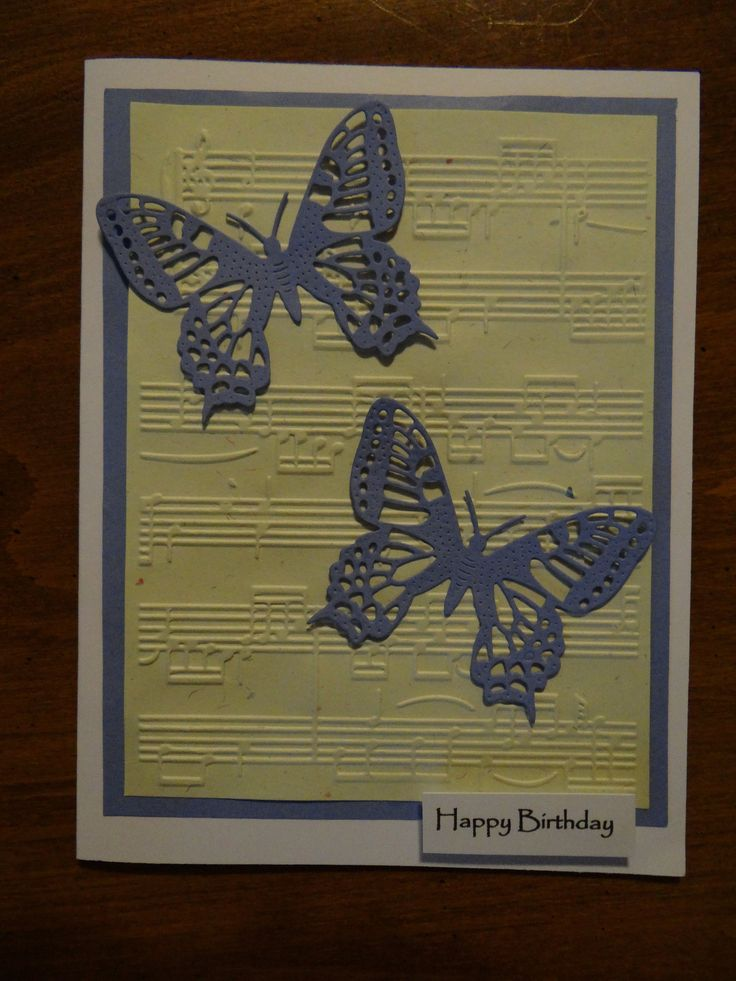 birthday card - music embossed on hand made paper - background and lavender butterflies match flecks in paper