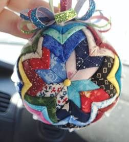 "a ""scrappy"" quilted ornament."