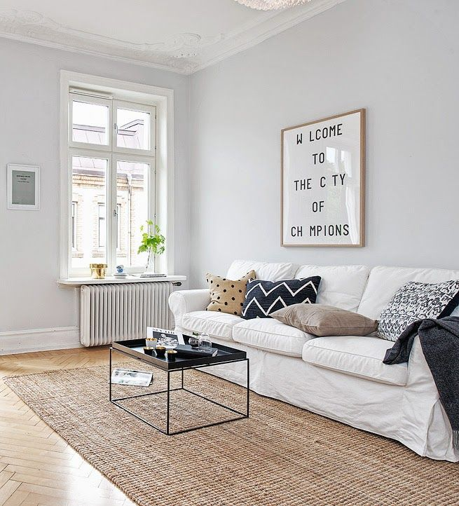 Cosy Swedish living room with a table from Hay. Via The Design Chaser.